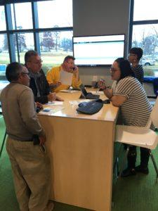 Code Enforcement staff helping customers.