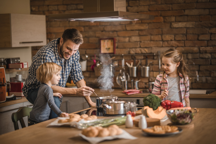Family cooking food safely for the holidays