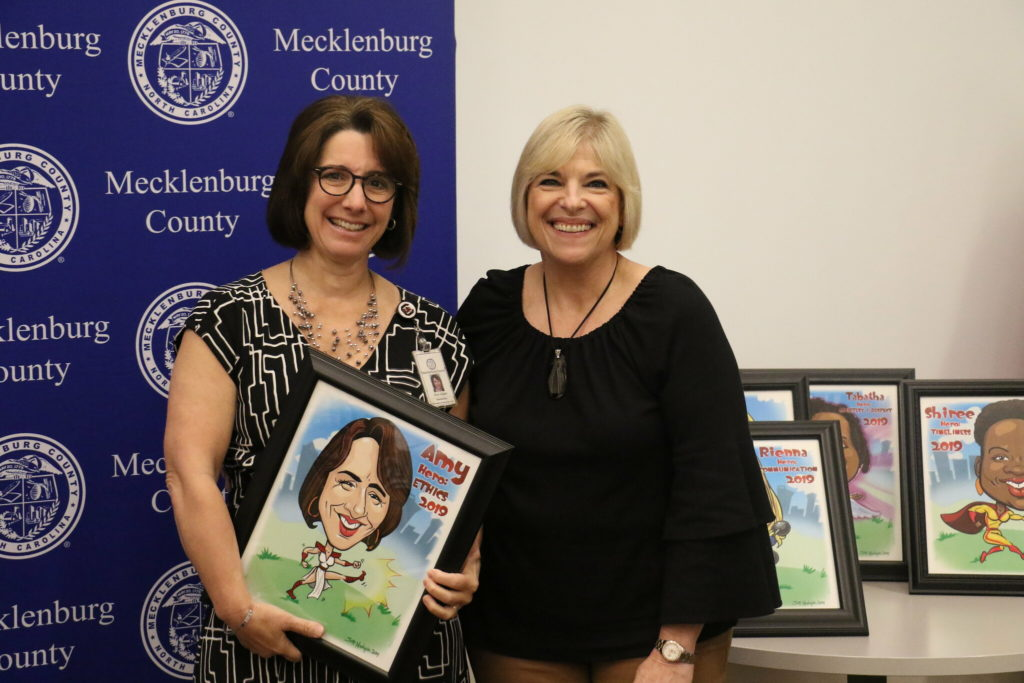 Ethics winner Amy Gilliam poses with County Manager Dena R. Diorio while accepting her Customer Service Hero Award.