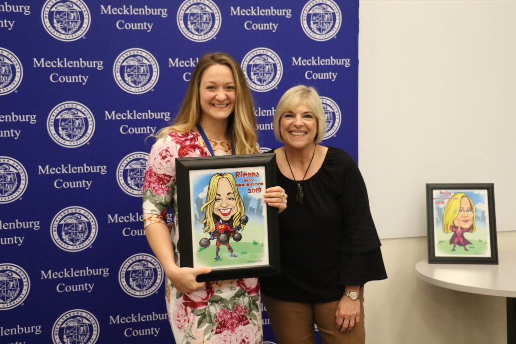 Communication winner Rienna Nuber poses with County Manager Dena R. Diorio while accepting her Customer Service Hero Award.
