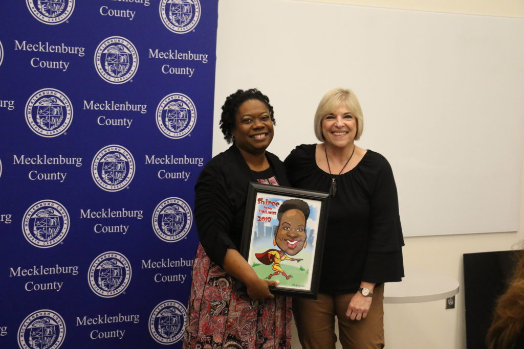 Timeliness winner Shiree Lewis poses with County Manager Dena R. Diorio while accepting her Customer Service Hero Award.