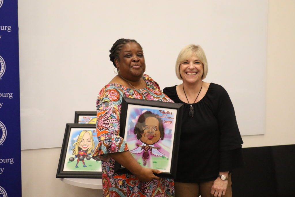 Courtesy and Respect winner Tabatha Howard poses with County Manager Dena R. Diorio while accepting her Customer Service Hero Award.