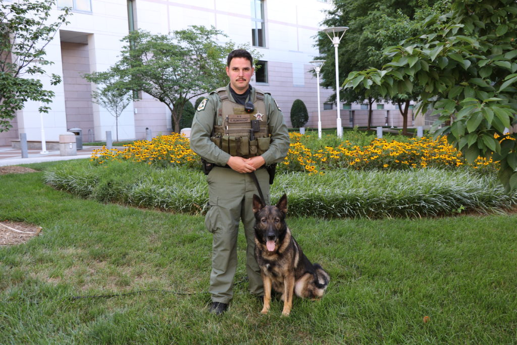Mecklenburg County Sheriff's Deputy Elmendorf poses with his K-9 Nilz.