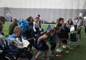 group of people having fun cheerleading on a sideline